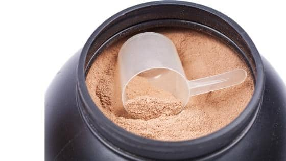 Whey protein powder with a scoop.