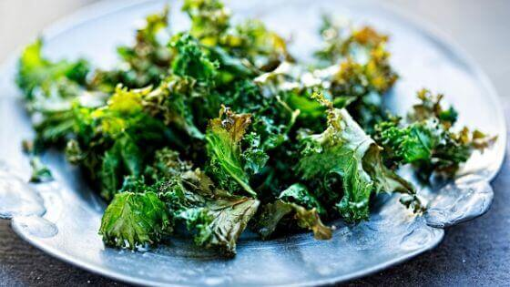 Baked kale chips with coconut oil. One of the greatest low-carb snacks for weight loss.