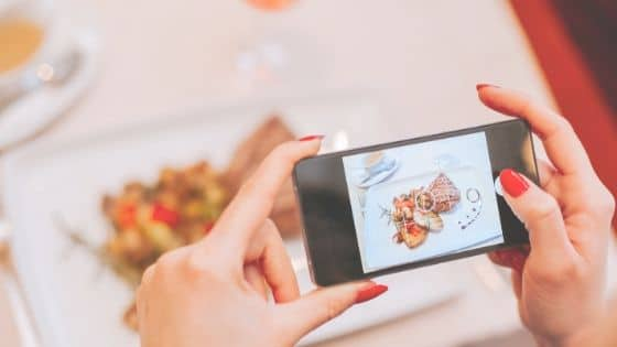 Woman taking a picture of her food as a trick to lose weight.