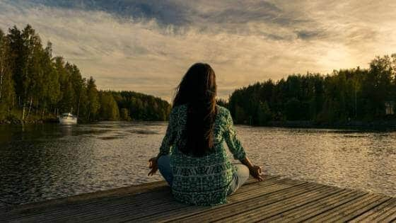 Image of a woman meditating.